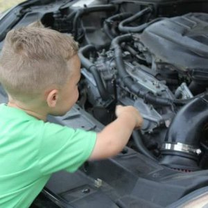 "So far the best thing he is good at is ""hey son, hand me the wrench""...""this one daddy???""...😂😂  FB IMG 1443406126"